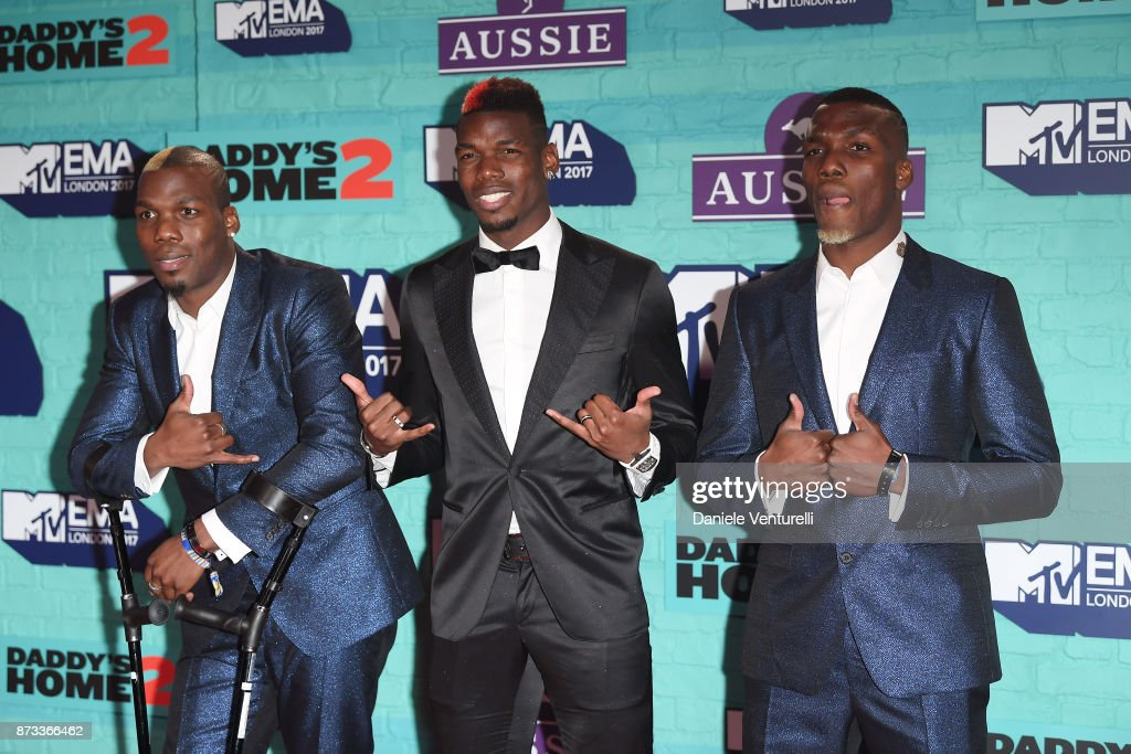 Manchester United's Paul Pogba (C) and his brothers Florentin Pogba (L) and Mathias Pogba (R) attend the MTV EMAs 2017 held at The SSE Arena, Wembley on November 12, 2017 in London, England.
