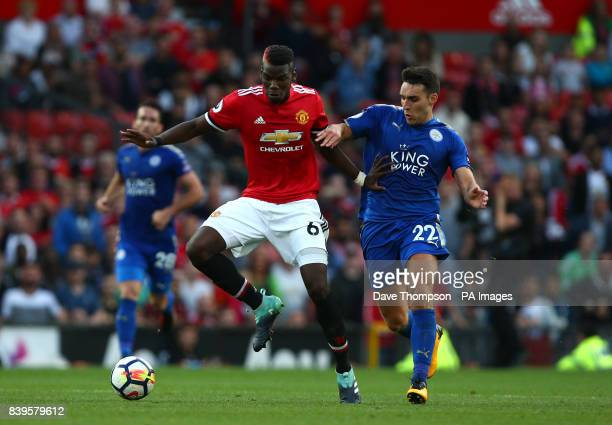Manchester United's Paul Pogba and Leicester City's Matty James battle for the ball during the Premier League match at Old Trafford Manchester