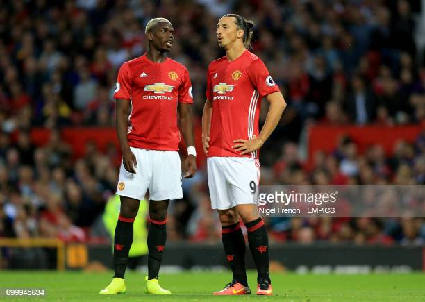 Manchester United's Paul Pogba and Manchester United's Zlatan Ibrahimovic speak during the match