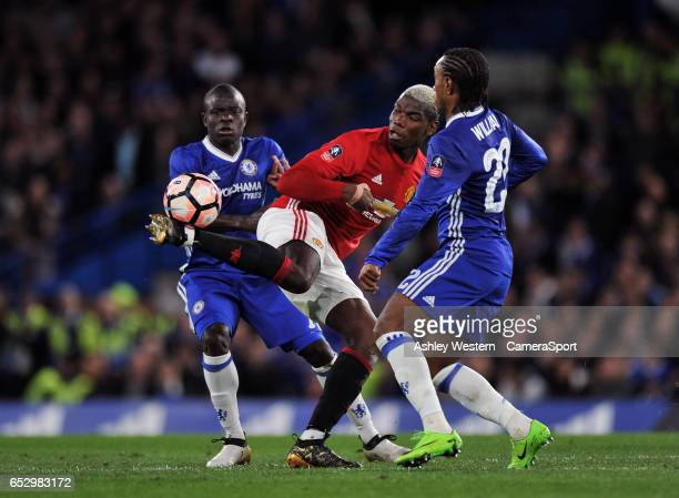 Manchester United's Paul Pogba battles for possession with Chelsea's Ngolo Kante and Willian during the Emirates FA Cup QuarterFinal match between...