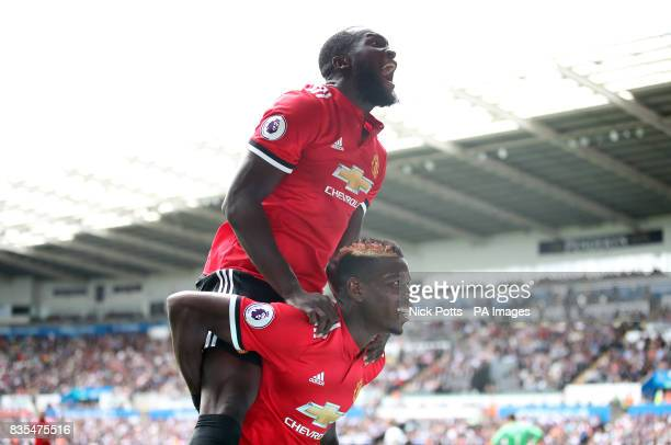 Manchester United's Paul Pogba celebrates scoring his side's third goal with teammate Romelu Lukaku during the Premier League match at the Liberty...