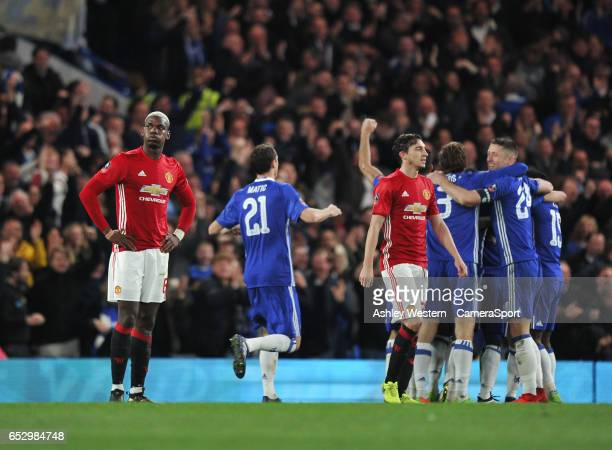 Manchester United's Paul Pogba dejected as Chelsea's Ngolo Kante scores the opening goal during the Emirates FA Cup QuarterFinal match between...