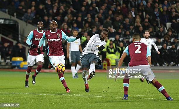 Manchester United's Paul Pogba gets in a shot in the second half during the Premier League match between West Ham United and Manchester United at...