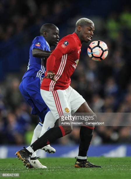 Manchester United's Paul Pogba holds off the challenge from Chelsea's Ngolo Kante during the Emirates FA Cup QuarterFinal match between Chelsea and...