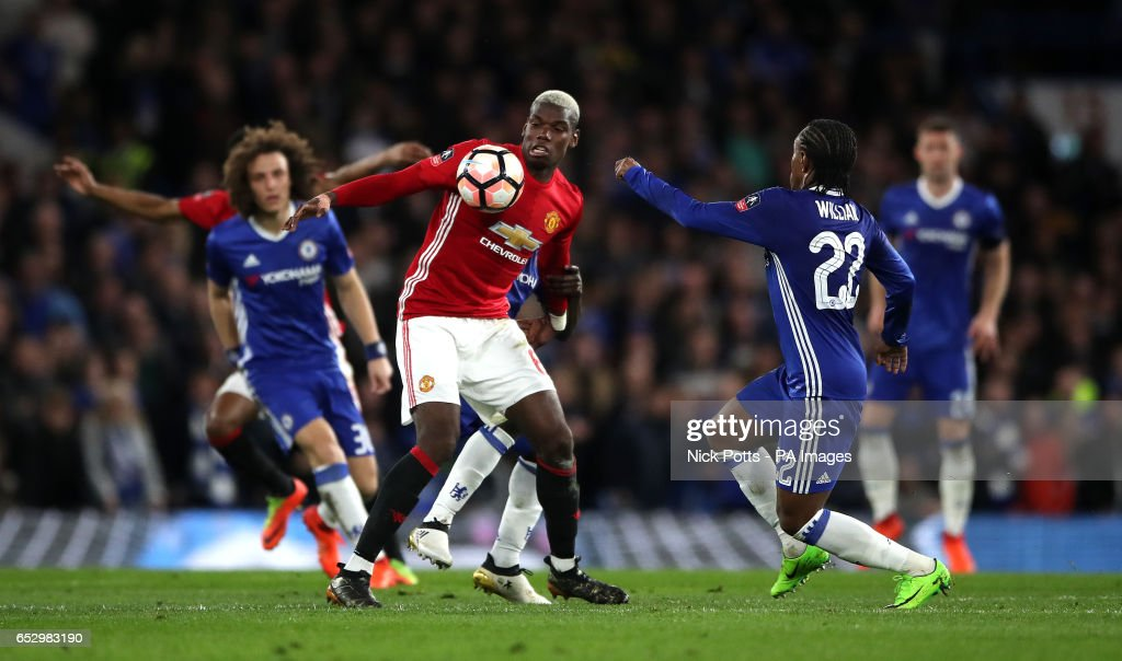 Manchester United's Paul Pogba is challeneged by Chelsea's Willian (right) during the Emirates FA Cup, Quarter Final match at Stamford Bridge, London.