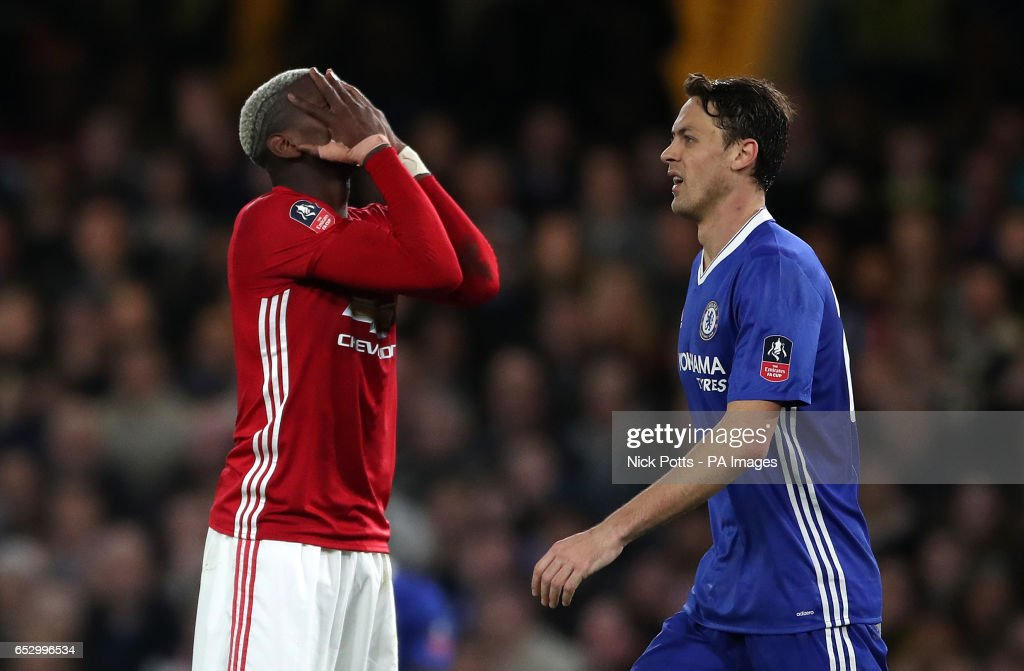 Manchester United's Paul Pogba (left) looks dejected during the Emirates FA Cup, Quarter Final match at Stamford Bridge, London.