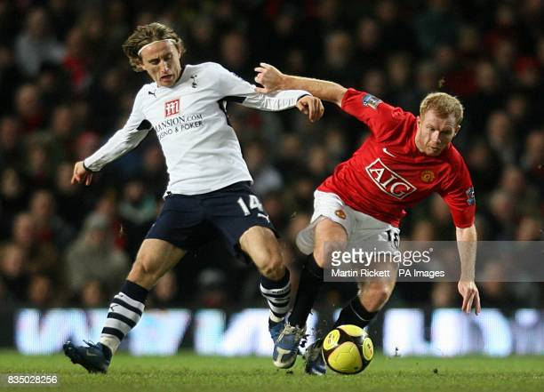 Manchester United's Paul Scholes and Tottenham Hotspur's Luka Modric battle for the ball