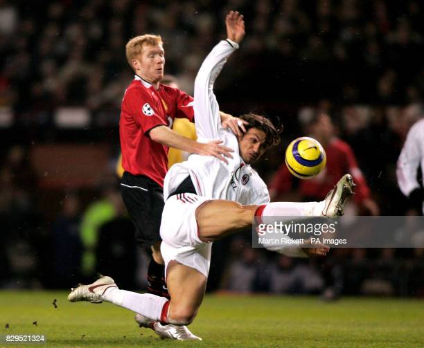 Manchester United's Paul Scholes challenges Paolo Maldini of AC Milan for the ball