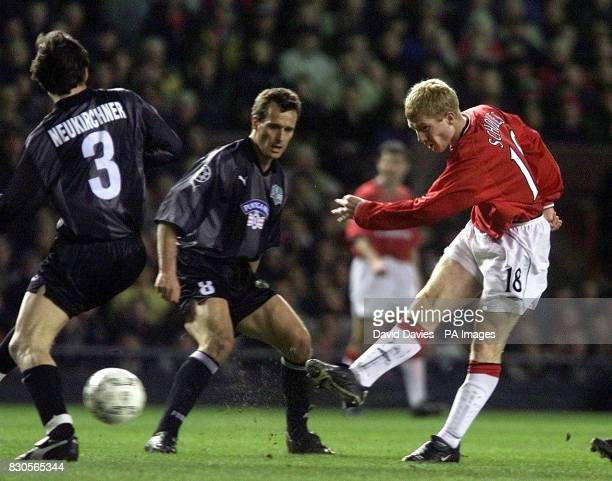 LEAGUE Manchester United's Paul Scholes has his shot blocked by SK Sturm Graz's Gunther Neukirchner during the Champions League Group A game at Old...