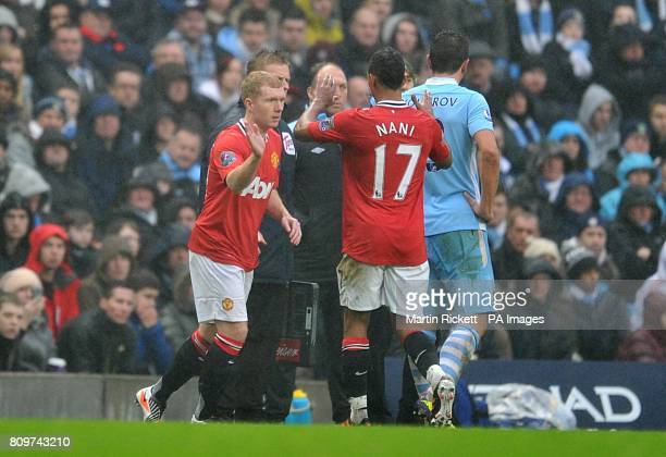 Manchester United's Paul Scholes is brought on for a substitute for teammate Luis Nani on his comeback from retirement for Manchester United