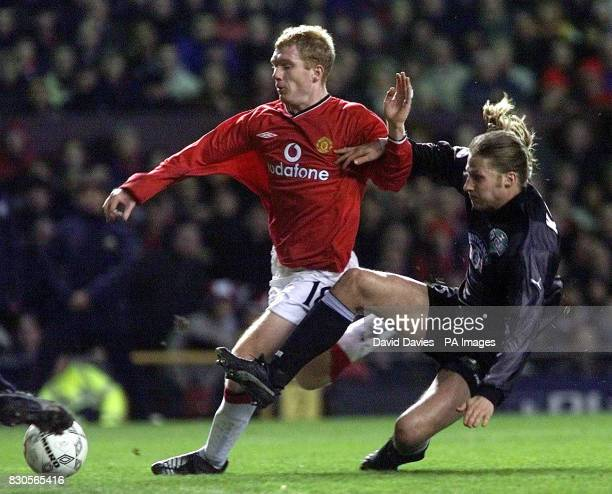 LEAGUE Manchester United's Paul Scholes is challenged by SK Sturm Graz's Gyorgy Korsos during the Champions League Group A game at Old Trafford...