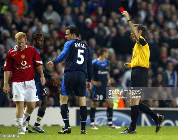 Manchester United's Paul Scholes is sent off against Lille by referee Stefano Farina