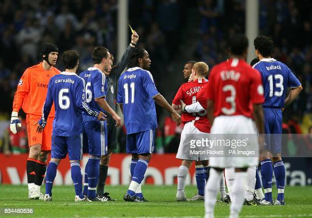Manchester United's Paul Scholes is shown a yellow card for catching Chelsea's Claude Makelele as they battled for the ball in the air