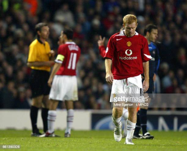 Manchester United's Paul Scholes walks away dejected after being sent off against Lille by referee Stefano Farina