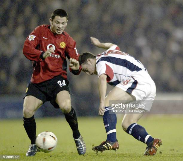 Manchester United's Phil Bardsley screens the ball from West Bromwich Albion's Jason Koumas during the fourth round of the FA Carling Cup match at...