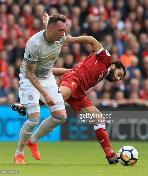 Manchester United's Phil Jones and Liverpool's Mohamed Salah battle for the ball during the Premier League match at Anfield Liverpool