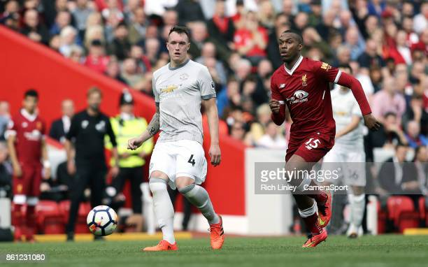 Manchester United's Phil Jones passes despite the attentions of Liverpool's Daniel Sturridge during the Premier League match between Liverpool and...