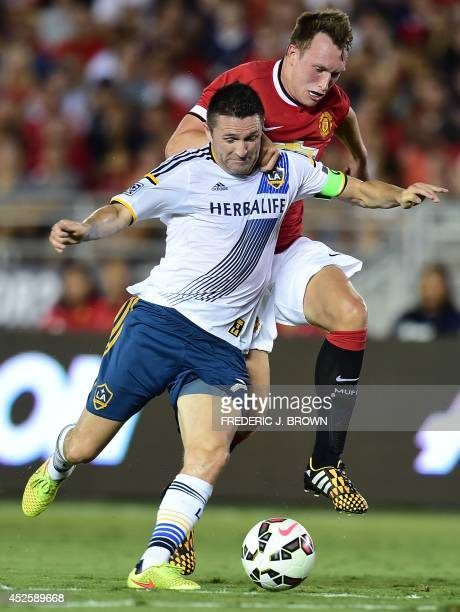 Manchester United's Phil Jones vies for the ball with Robbie keane of the LA Galaxy during their Chevrolet Cup match at the Rose Bowl in Pasadena...