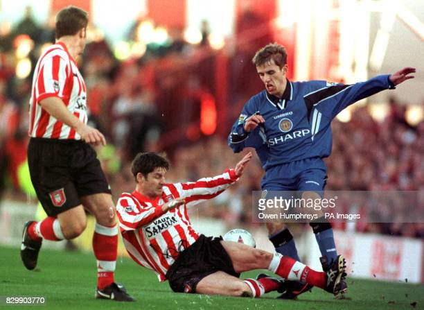 Manchester United's Phil Neville tackles Sunderland's Paul Bracewell at Roker Park today Sunderland caused an upset beating the league leaders 20...
