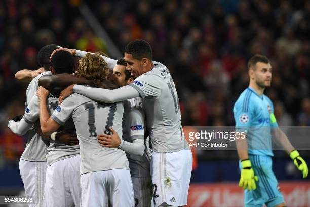 Manchester United's players celebrate their team's third goal as CSKA Moscow's goalkeeper from Russia Igor Akinfeev walks past during the UEFA...