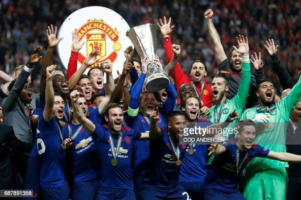 Manchester United's players celebrates with the trophy after the UEFA Europa League final football match Ajax Amsterdam v Manchester United on May 24...