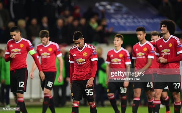 TOPSHOT Manchester United's players look dejected as they leave the pitch after the UEFA Champions League Group B secondleg football match VfL...