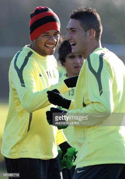 Manchester United's Portugese forward Bebe laughs with Italian forward Federico Macheda during a team training session at their Carrington complex in...