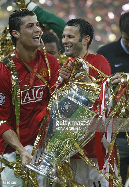Manchester United's Portugese midfielder Cristiano Ronaldo and Ryan Giggs celebrate with the trophy after beating Chelsea in the final of the UEFA...
