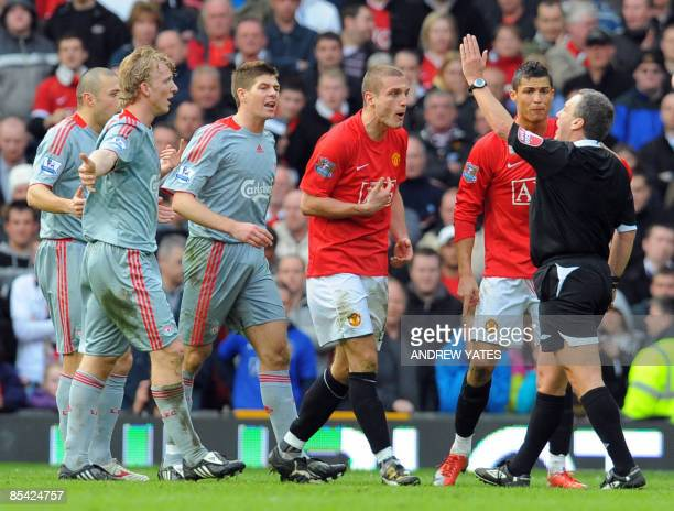 Manchester United's Portugese midfielder Cristiano Ronaldo appeals to referee Alan Wiley after Serbian defender Nemanja Vidic is sent off against...