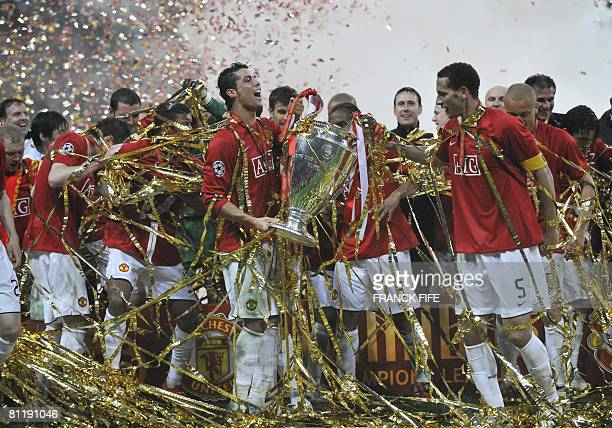 Manchester United's Portugese midfielder Cristiano Ronaldo celebrates with the trophy in front of their supporters after beating Chelsea in the final...