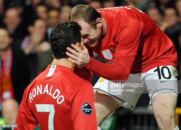Manchester United's Portugese midfielder Cristiano Ronaldo is congratulated by English forward Wayne Rooney after he scored against Inter Milan...