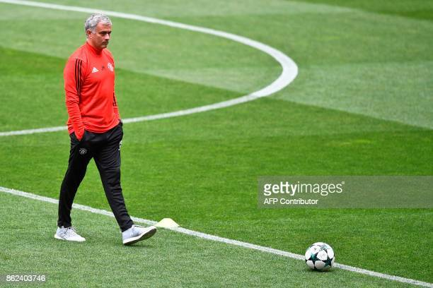 Manchester United's Portuguese coach Jose Mourinho attends a training session at the Luz stadium in Lisbon on October 17 2017 on the eve of the UEFA...