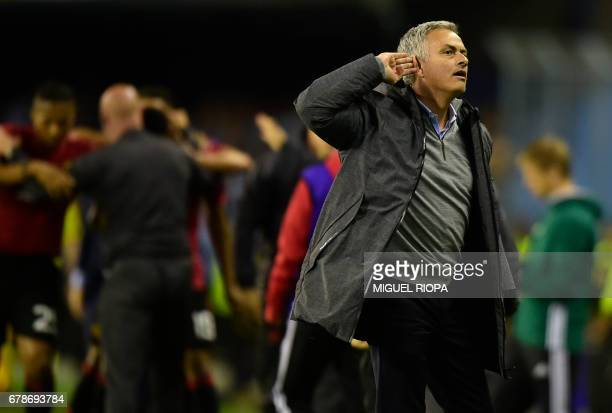 Manchester United's Portuguese coach Jose Mourinho gestures as he celebrates their opener during their UEFA Europa League semi final first leg...