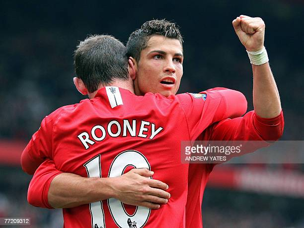 Manchester United's Portuguese forward Cristiano Ronaldo and Wayne Rooney celebrate Ronaldo's second goal after scoring the third goal against WIgan...