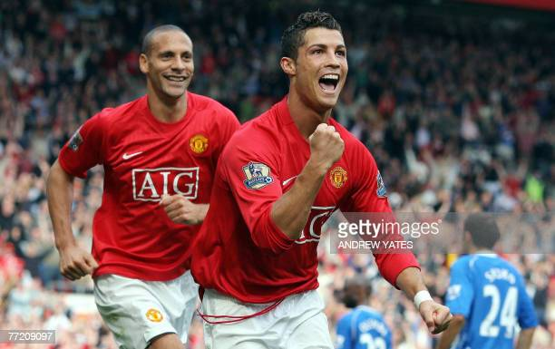 Manchester United's Portuguese forward Cristiano Ronaldo celebrates in front of teammate Rio Ferdinand after scoring the second goal against WIgan...