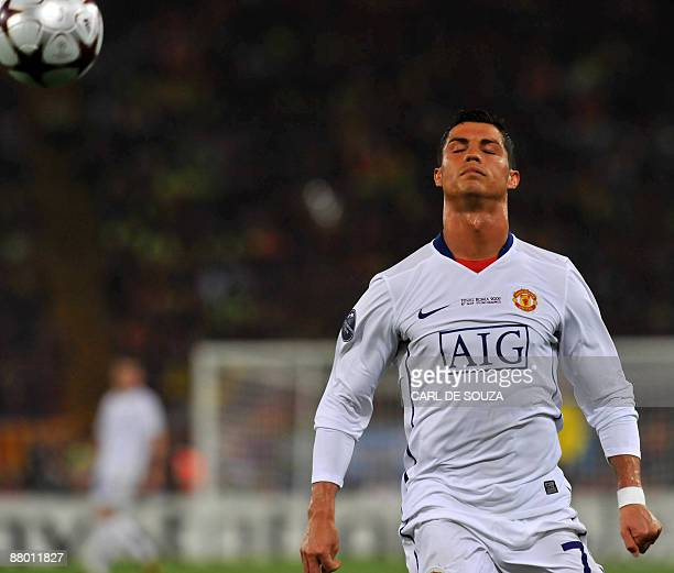 Manchester United's Portuguese forward Cristiano Ronaldo fails to stop a ball which leaves the pitch during the final of the UEFA football Champions...