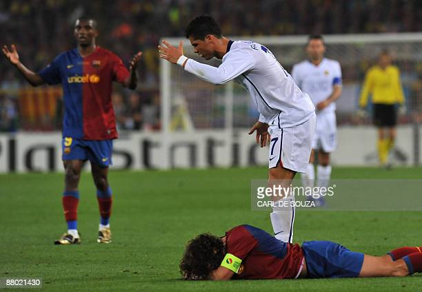 Manchester United's Portuguese forward Cristiano Ronaldo reacts after fouling Barcelona´s captain and defender Carles Puyol during their Champions...