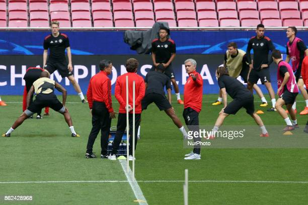 Manchester United's Portuguese head coach Jose Mourinho and team players attend a training session at the Luz stadium in Lisbon Portugal on October...