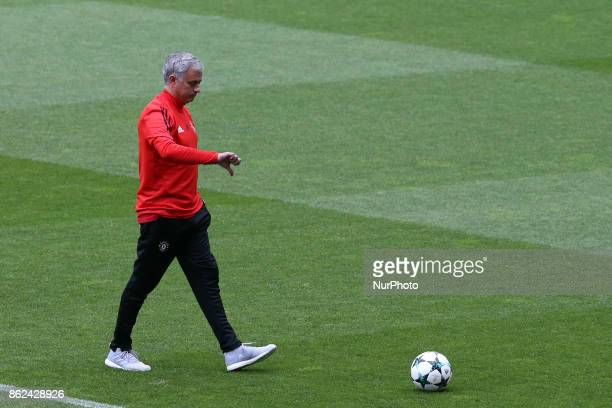 Manchester United's Portuguese head coach Jose Mourinho attends a training session at the Luz stadium in Lisbon Portugal on October 17 on the eve of...
