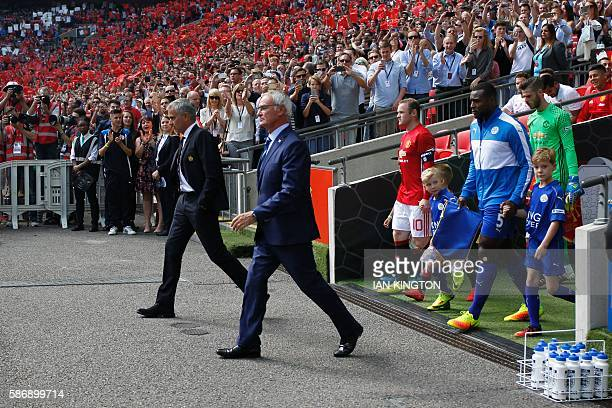 Manchester United's Portuguese manager Jose Mourinho and Leicester City's Italian manager Claudio Ranieri lead out their team captain's Leicester...