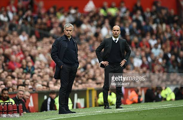 Manchester United's Portuguese manager Jose Mourinho and Manchester City's Spanish manager Pep Guardiola watch from the touchline during the English...