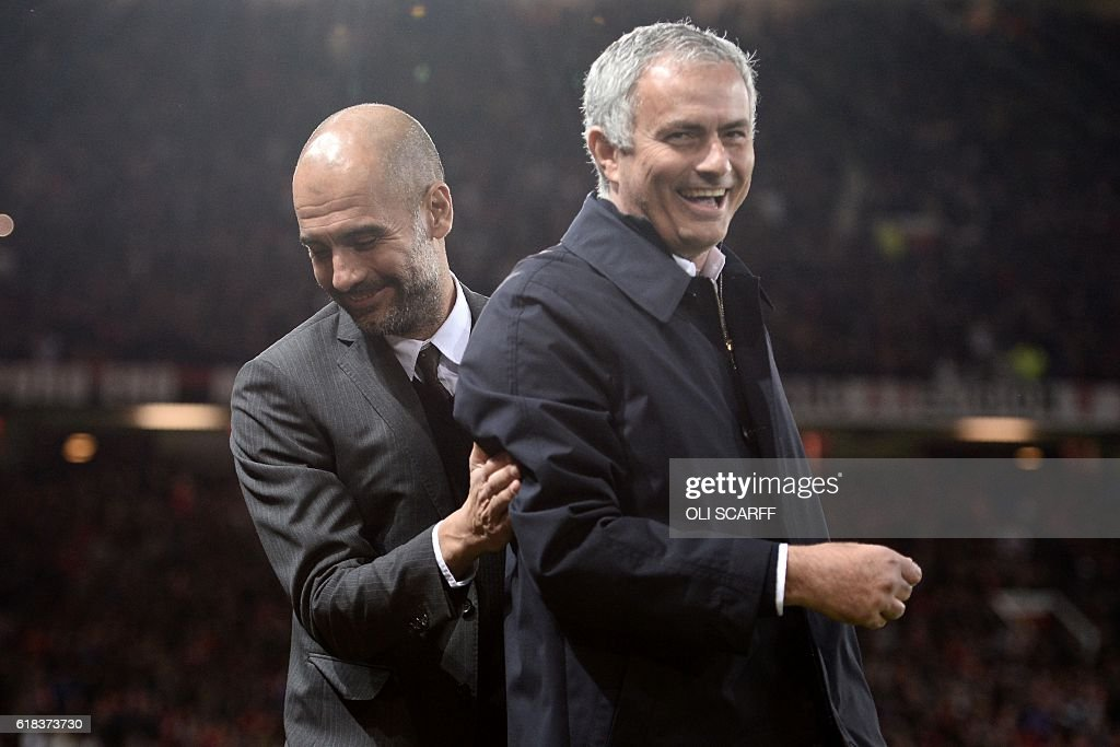 Manchester United's Portuguese manager Jose Mourinho (R) and Manchester City's Spanish manager Pep Guardiola share a joke ahead of the EFL (English Football League) Cup fourth round match between Manchester United and Manchester City at Old Trafford in Manchester, north west England on October 26, 2016. / AFP / Oli SCARFF / RESTRICTED TO EDITORIAL USE. No use with unauthorized audio, video, data, fixture lists, club/league logos or 'live' services. Online in-match use limited to 75 images, no video emulation. No use in betting, games or single club/league/player publications. /