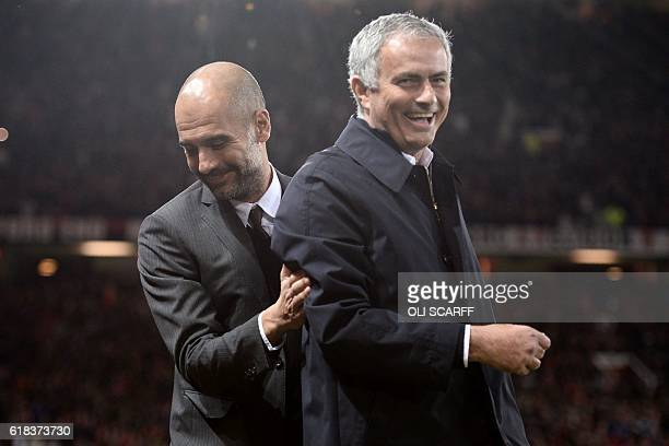 Manchester United's Portuguese manager Jose Mourinho and Manchester City's Spanish manager Pep Guardiola share a joke ahead of the EFL Cup fourth...