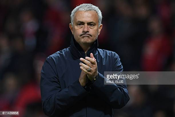 Manchester United's Portuguese manager Jose Mourinho applauds the fans following the UEFA Europa League group A football match between Manchester...