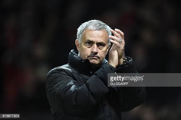 Manchester United's Portuguese manager Jose Mourinho appluads after the final whistle in the UEFA Europa League group A football match between...