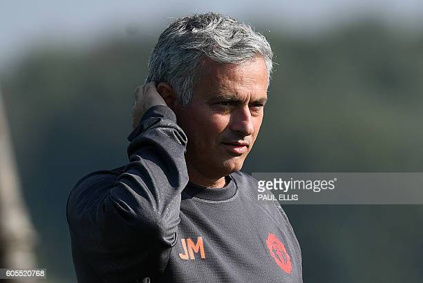 Manchester United's Portuguese manager Jose Mourinho arrives to host a team training session at their Carrington Training Centre in Manchester north...