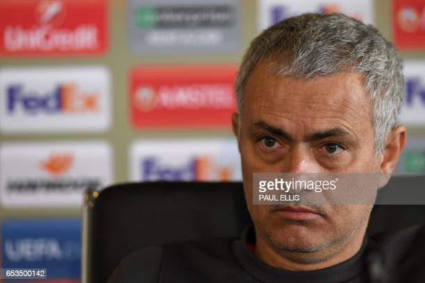 Manchester United's Portuguese manager Jose Mourinho attends a press conference at their Carrington base in Manchester north west England on March 15...