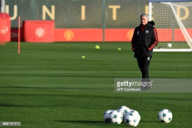 Manchester United's Portuguese manager Jose Mourinho attends a team training session at the club's training complex near Carrington west of...
