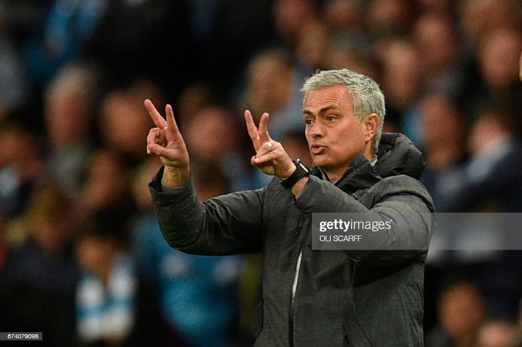 Manchester United's Portuguese manager Jose Mourinho gestures from the touchline during the English Premier League football match between Manchester City and Manchester United at the Etihad Stadium in Manchester, north west England, on April 27, 2017. / AFP PHOTO / Oli SCARFF / RESTRICTED TO EDITORIAL USE. No use with unauthorized audio, video, data, fixture lists, club/league logos or 'live' services. Online in-match use limited to 75 images, no video emulation. No use in betting, games or single club/league/player publications. /