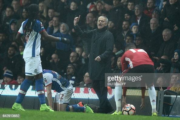 Manchester United's Portuguese manager Jose Mourinho gestures on the touchline during the English FA Cup fifth round football match between Blackburn...